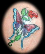 Photos tatouages pictures tattoos 12 Mania tattoo.com tattoo butterfly and flower